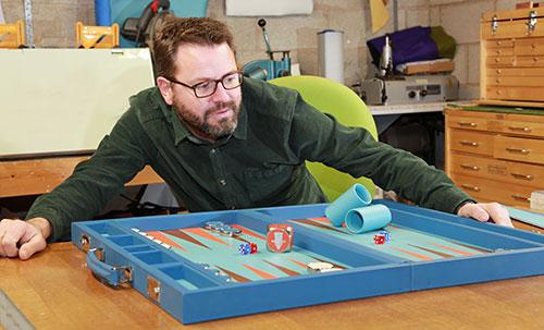 Guy Haslam at work on a chances luxury backgammon board